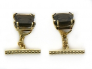 Золотые запонки с вставкой топаз