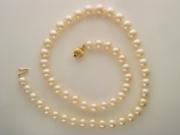 Золотое ожерелье с вставкой жемчуг